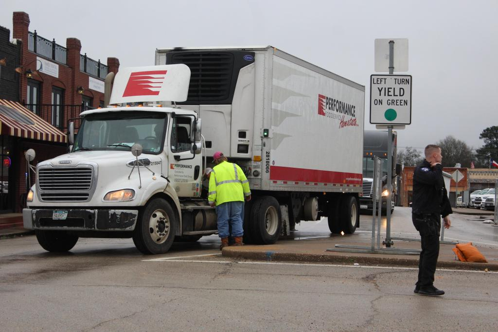 A crew from Sand Hill Wrecker service came to the rescue with fuel for a truck stranded downtown Wednesday.