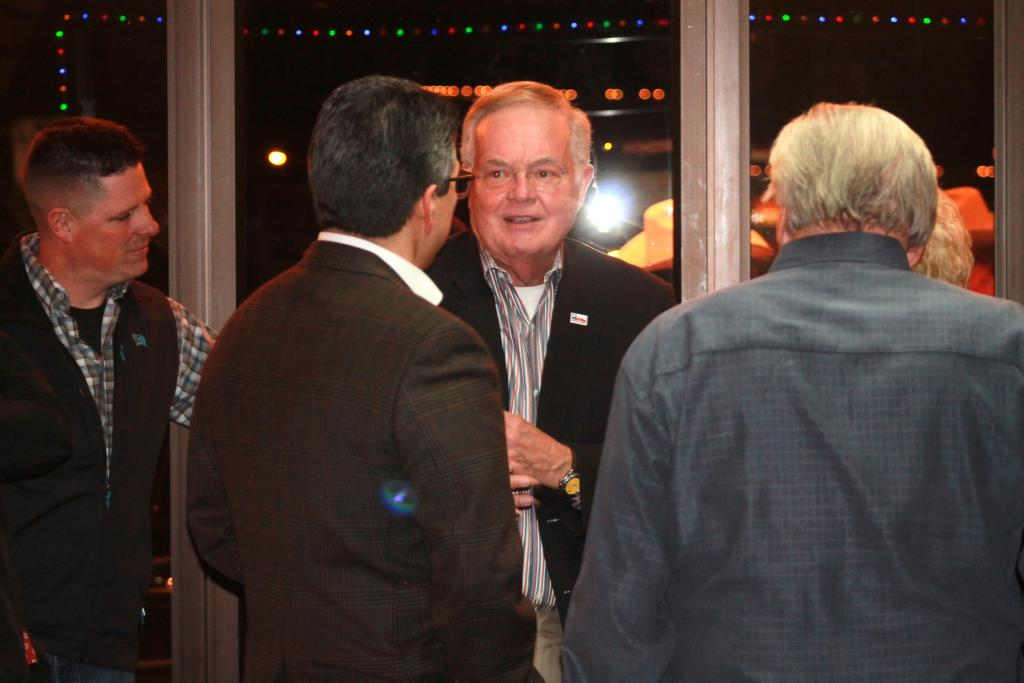 Texas Railroad Commission Chairman Wayne Christian vists with State Rep. Chris Paddie.