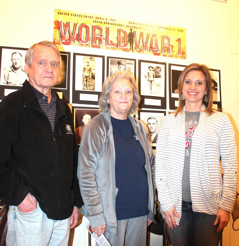 Leonard Irish, treasurer, Venorah McSwain, president, and Anna Lee with Center Glass, lifetime Shelby County Museum member are seen at the museum with part of the exhibition highlighting World War I which is on display now.