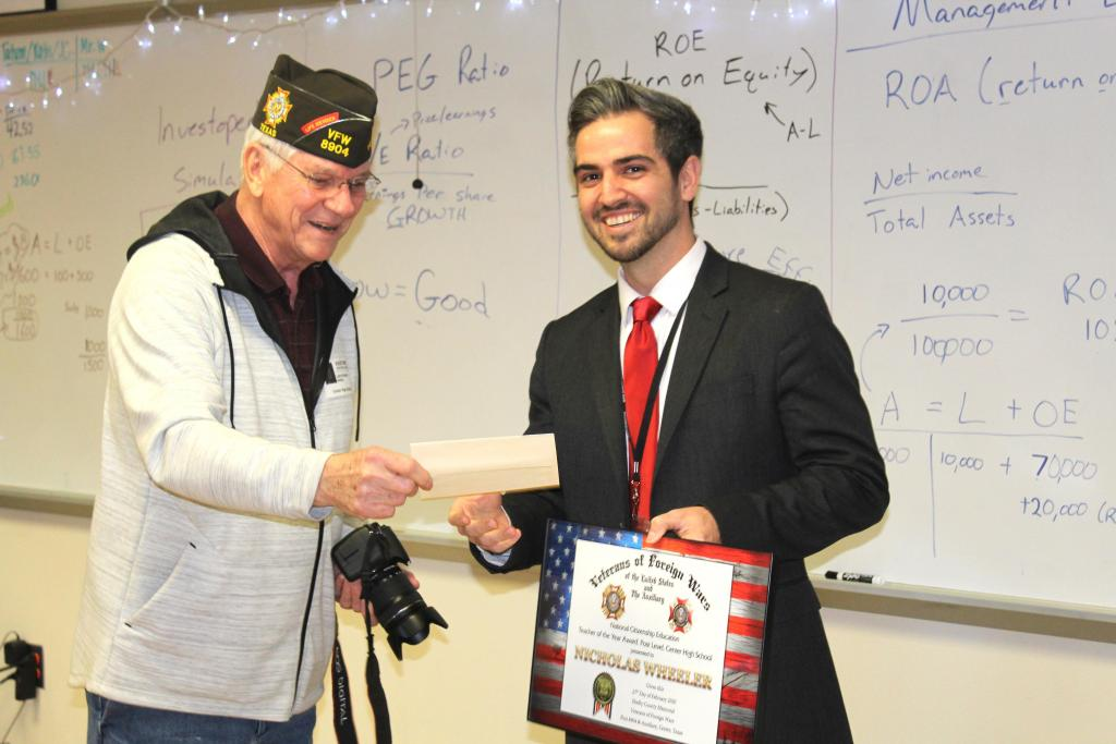 Larry Hume, VFW Post 8904 quartermaster, presented a check to CHS teacher Nicholas Wheeler on Thursday at Post 8904 Teacher of the Year.