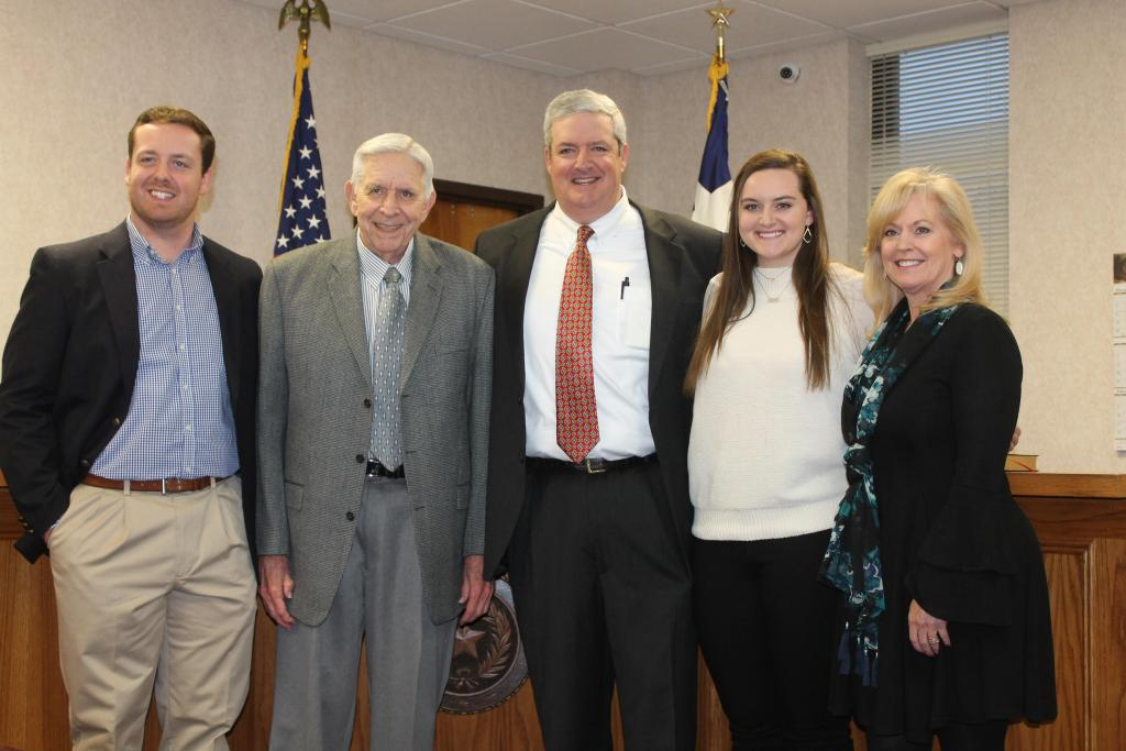 Newly invested 273rd District Judge James A. Payne Jr., center, is seen with family members James Payne, James Allen Payne, Sr.,  Maddie Payne and Jill Payne after his swearing in ceremony on Jan. 3.