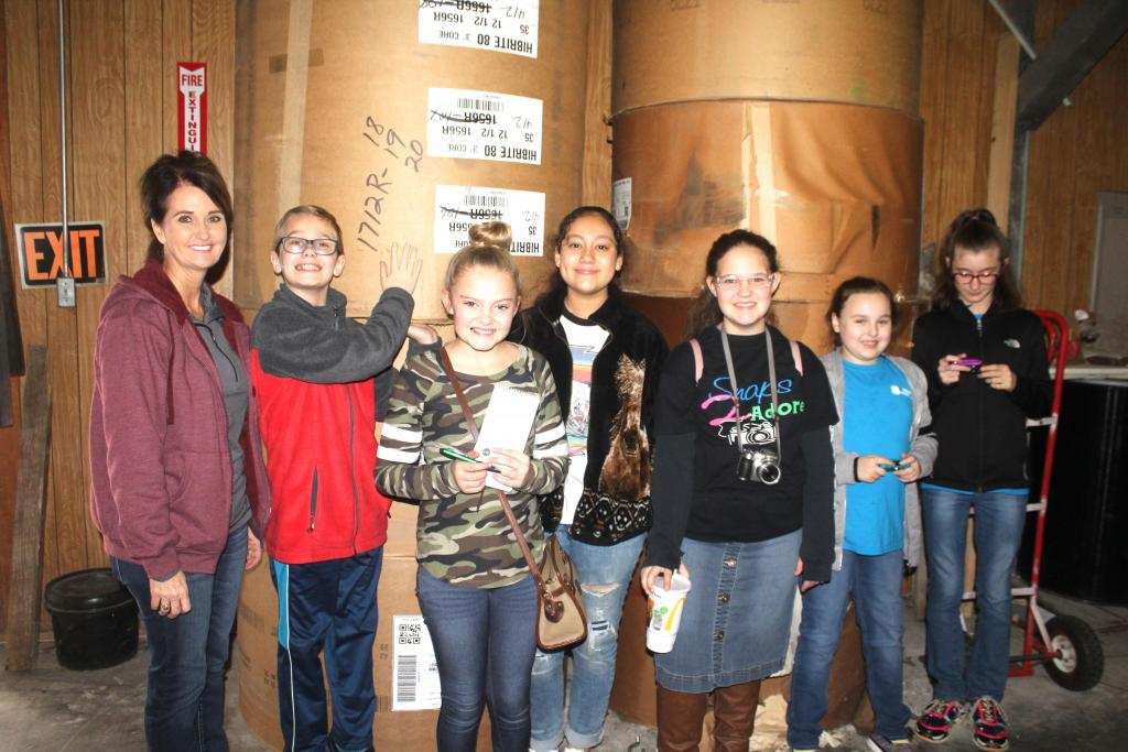 4-Hers with rolls of newsprint weighing as much as 700-to-800 pounds each.