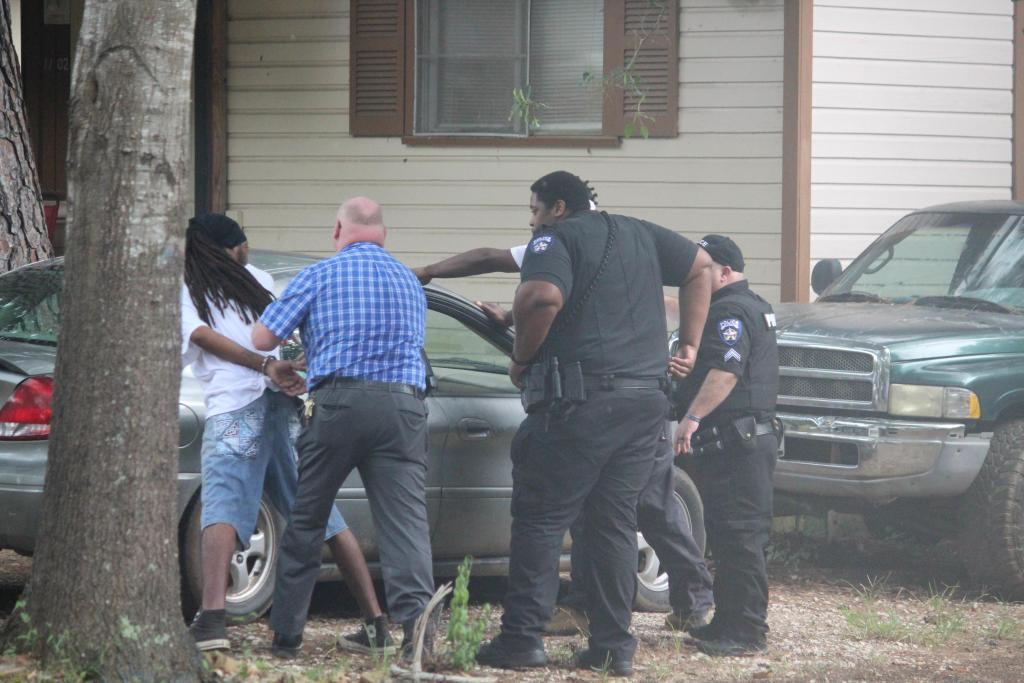 Center Police are seen making an arrest on Sampson Street Monday afternoon soon after an armed assault was reported a couple of blocks away on Kindle Street. It is not known if the arrest and assault are related.