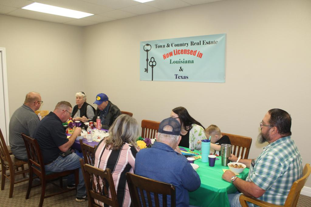 Town and Country Real Estate kicked off an announcement of expanding into Louisiana with a Mardi Gras themed lunch.
