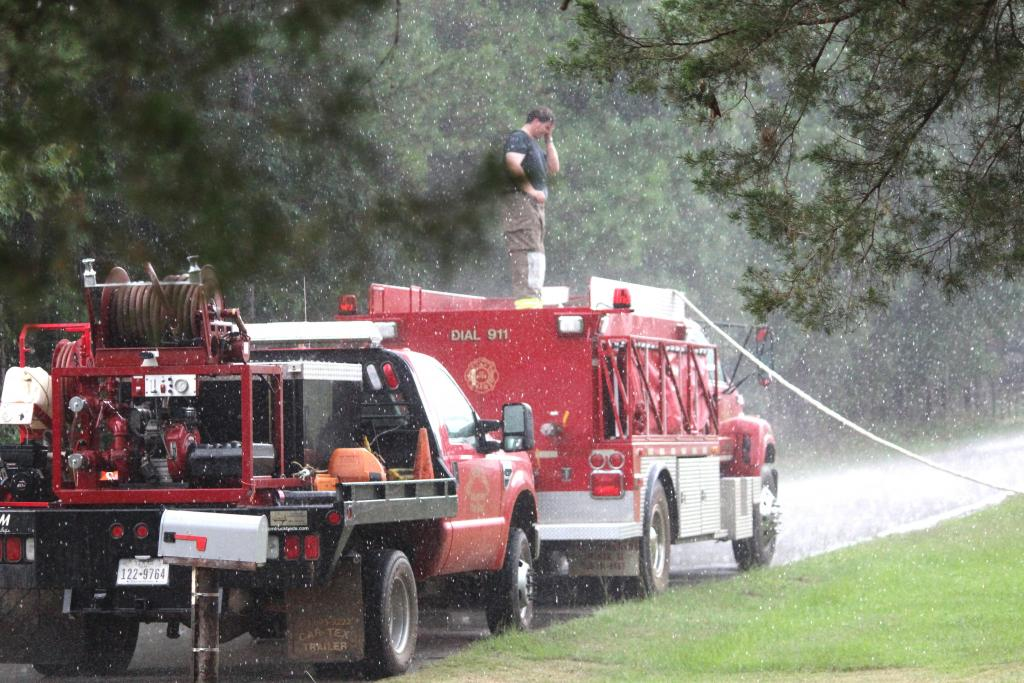 Firefighters headed to the nearby Lake Pinkston Water Treatment plant to refill water tanks as rain fell.