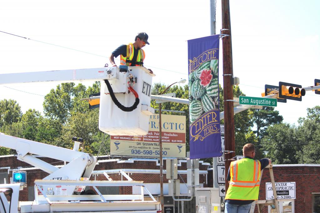It was down with the Watermelon banners and up with Poultry Fest banners on Tuesday for city crews.