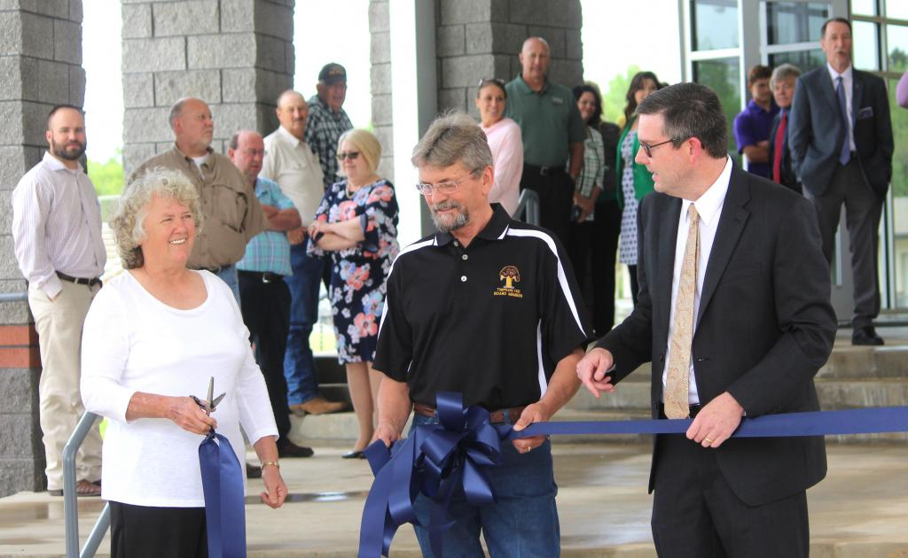 Ribbon cutting with TISD Board members Joyce Wolfe and Dannie Hunt along with Supt. Mid Johnson, right.