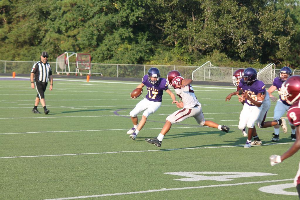 Mason Perry, No. 17 for the Roughrider freshman team, is seen working on evading an Athens tackler.