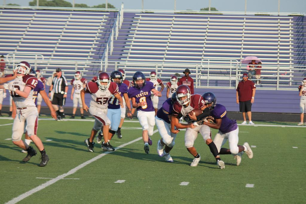 A pair of Center defensive players work on bringing down an Athens ball carrier in Thursday's freshman game.