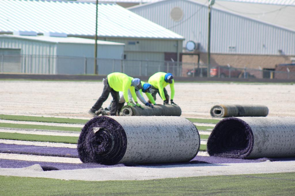 Work started on replacing artificial turf at Roughrider Stadium this week.