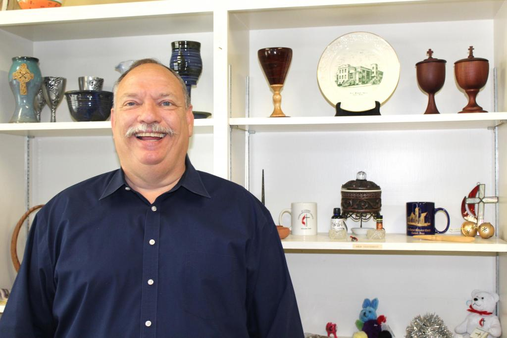 Mementos and souvenirs from his travels around the globe line the shelves of Rev. Malcolm Monroe's office at Center First United Methodist Church as he has been busy unpacking and getting settled in as the congregation's new pastor. (Mike Elswick/The Light and Champion)