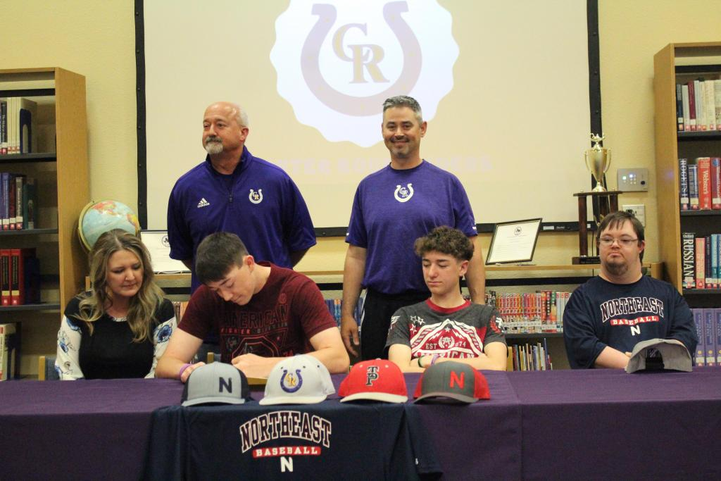 Jaxon Covington signs letter of intent to Northeast Texas Community College. (Standing from left to right): Athletic Director, Barry Bowman, and Head Baseball Coach, Kelly Spann.  Photo: Cheyenne Byrnes