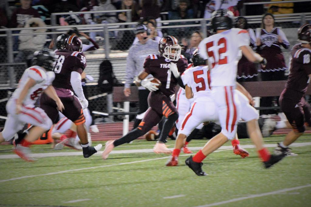 Tenaha playmaker Jay Lloyd (maroon #1) weaves the ball through several Shelbyville Dragon defenders during round one of playoff action. (Photo by Taylor Bragg, Freelance Photographer.)