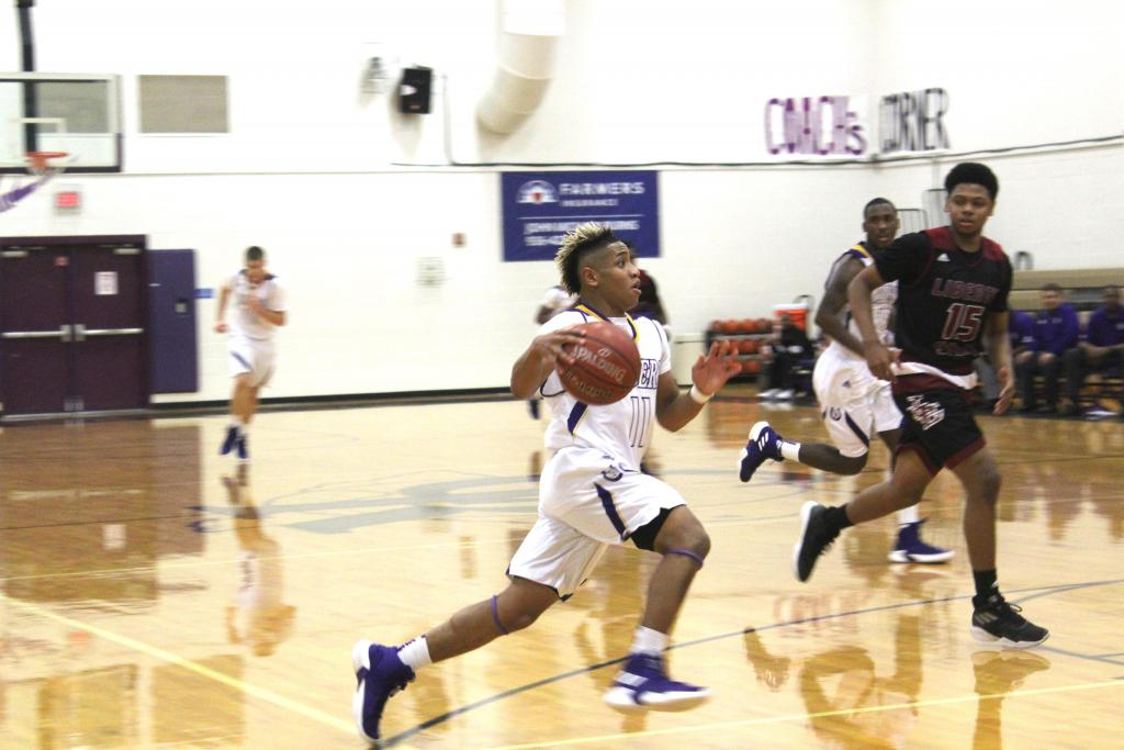 Jayden Hicks drives hard to the basket in a tough loss to Liberty-Eylau. Hicks showed up for the Riders in a big way adding 28 points to their total. (Photo by Leonardo Ariza, Freelance photographer/The Light and Champion))