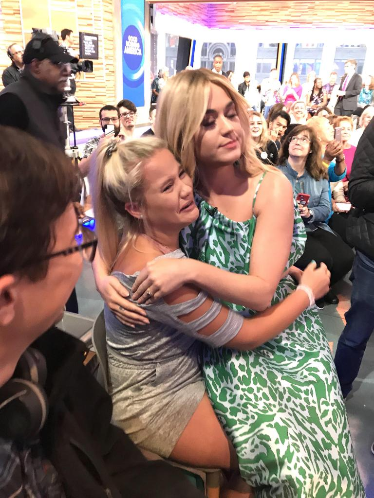 Cassidy Clifton receives an embrace from Katy Perry during a Timpson Band trip to NYC for seniors.