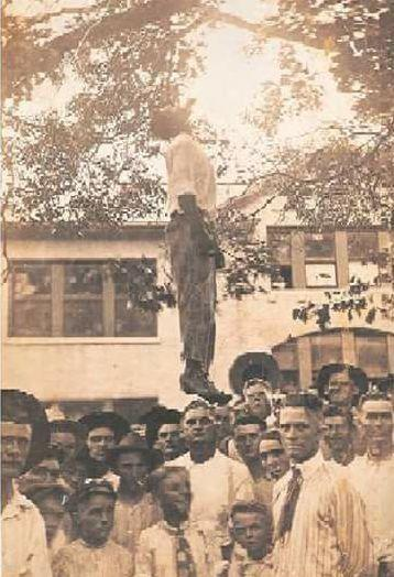 The lynching of 16-year-old Lige Daniels on the Shelby County Courthouse lawn as captured on a historic photo used on a post card.
