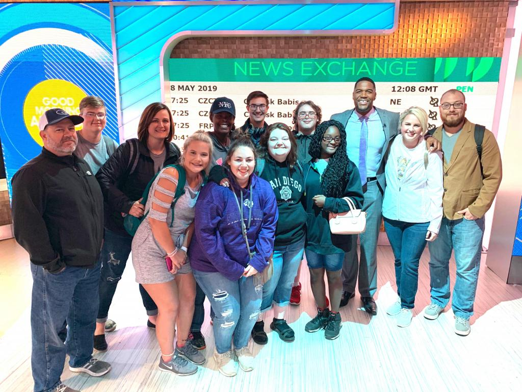 """Michael Strahan of """"Good Morning America,"""" poses with Timpson Band senior group on May 8."""