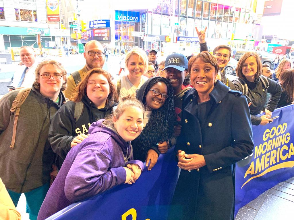 Good Morning America host Robin Roberts, front right, poses with Timpson group in NYC.