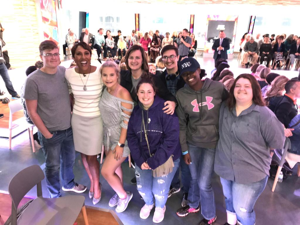 CBS' Robin Roberts, second from left, poses with Timpson band students and sponsors.
