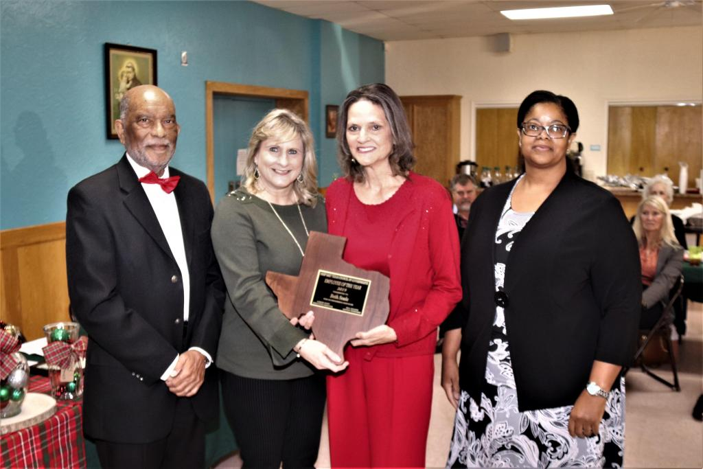 Pictured with Seale (from Left) are: (from left)  DETCOG Vice President, Nacogdoches City Councilman Roy Boldon, next is DETCOG Secretary, Shelby County Judge, Allison Harbison, DETCOG Employee of the Year Beth Seale and DETCOG Immediate Past President, Houston County Attorney, Daphne Session,