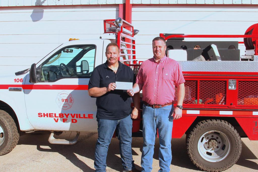 Aethon Energy's Kelly Tompkins, Texas District Foreman, left, presents a donation for the Shelbyville Volunteer Fire Department to Chris Koltonski, Shelbyville VFD Fire Chief. The Shelbyville VDF has plans to use the donation for several needed items for the department.