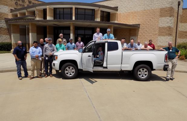 Members of the Center Noon Lions Club gather around the 2018 GMC Canyon extended cab pickup which is the grand prize in a drawing to be held Oct. 6. The truck is valued at more than $26,000.